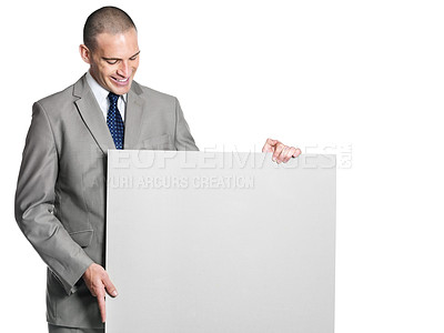 Buy stock photo Portrait of a confident young business man holding an empty billboard against white background