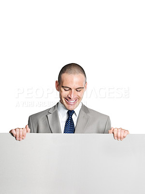 Buy stock photo Portrait of a successful young male entrepreneur holding a blank billboard against white background