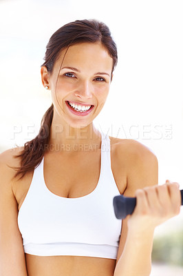 Buy stock photo Portrait of charming young woman working out with free weights