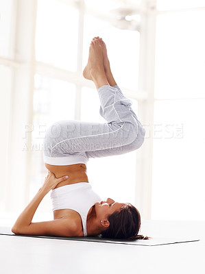 Buy stock photo Portrait of healthy young woman doing yoga exercise with legs raised in air