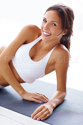 Buy stock photo Portrait of young woman smiling while lying on yoga mat