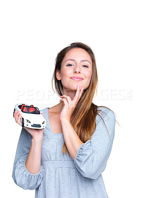 Buy stock photo Portrait of a beautiful young woman thinking to purchase a new car against white background