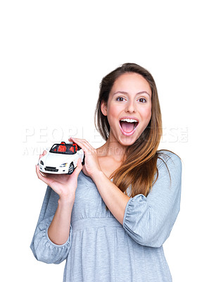 Buy stock photo Portrait of an excited young female fond of new cars against white background