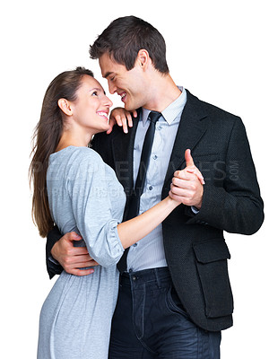 Buy stock photo Portrait of a romantic young couple dancing together against white background