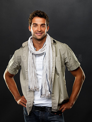 Buy stock photo Portrait of handsome man wearing a casual fashion ensemble smiling confidently, against a dark grey background