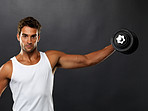 Young man lifting dumbbell