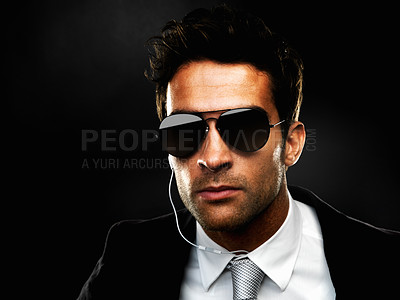 Buy stock photo Closeup of secret agent standing on black background