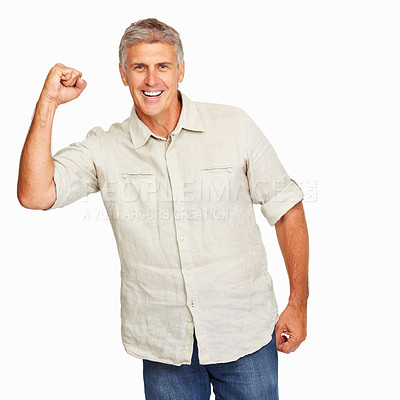 Buy stock photo Studio shot of a mature man cheering in victory against a white background