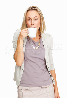Buy stock photo Portrait of pretty mature woman sipping tea over white background