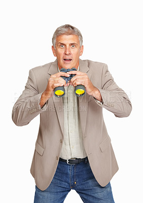 Buy stock photo Studio shot of a mature man searching with binoculars and looking surprised against a white background