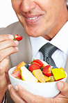 Business man eating strawberry