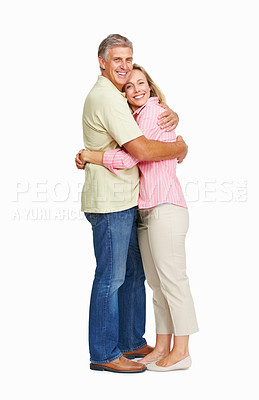 Buy stock photo Portrait of a happy couple embracing each other over white background