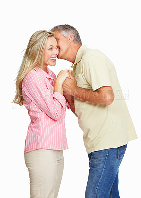 Buy stock photo Portrait of romantic mature man whispering in his wife's ear over white background
