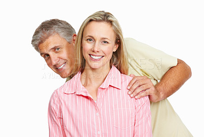 Buy stock photo Playful mature couple enjoying themselves over white background