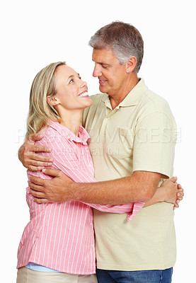 Buy stock photo Portrait of smiling romantic mature couple holding each other on white background