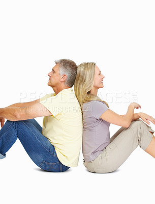 Buy stock photo Portrait of happy mature couple sitting back to back on white background
