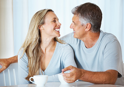Buy stock photo Portrait of romantic mature couple looking at each other indoors