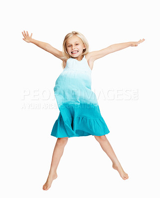 Buy stock photo Full length of cheerful young girl jumping in joy over white background with copypsace
