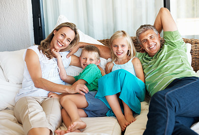 Buy stock photo Portrait of happy family lying on the bed at home