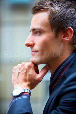 Buy stock photo Young Businessman full of ideas looking out of window.