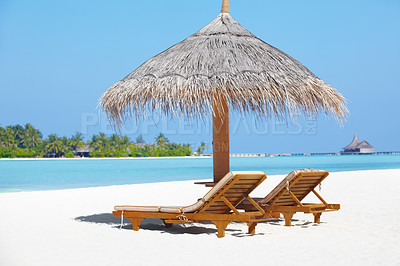 Buy stock photo Beautiful image of the beach with two chairs and a palm umbrella - Paradise