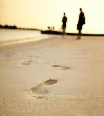 Buy stock photo Detail of a human footprints on sand walking on the beach
