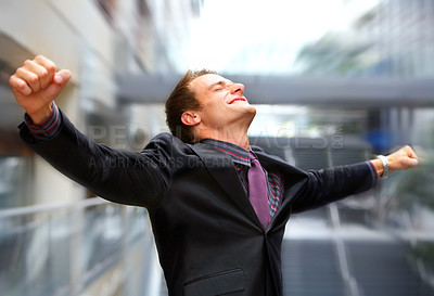 Buy stock photo Champion business man standing with fists clenched in victory.