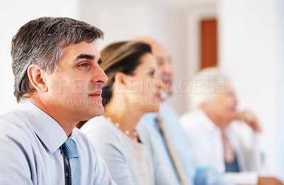 Buy stock photo Business colleagues sitting in row on business presentation and paying attention