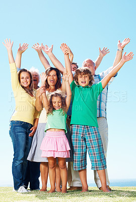 Buy stock photo Caucasian family raising hands outdoors against clear blue sky, 3 generation