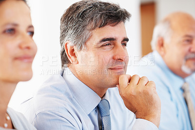 Buy stock photo Closeup portrait of happy business man with colleagues in a meeting