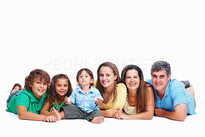Buy stock photo Happy parents with their children lying on floor on white background