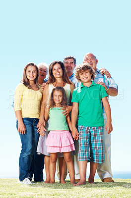 Buy stock photo Portrait of a senior couple with their family standing on grass - copyspace