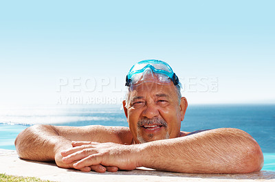 Buy stock photo Closeup of a smiling senior man resting on the edge of a swimming pool with goggles on his head - copyspace
