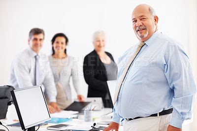 Buy stock photo Successful senior business man with colleagues in background