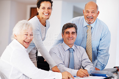 Buy stock photo Business man signing contract paper during corporate meeting