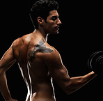 Trendy bodybuilder with tattoo lifts dumbbells against black