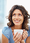 Closeup of a happy woman holding a coffee cup