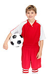 Cute young footballer with a soccer ball on white