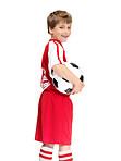 Happy small child with a football on white