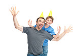 Excited father and son wearing birthday caps