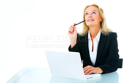 Buy stock photo Studio shot of a mature business woman working at a laptop isolated on white.