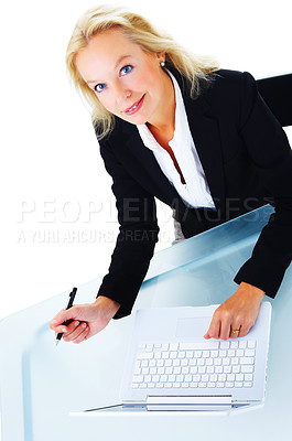 Buy stock photo Portrait of a mature business woman working at a laptop isolated on white.