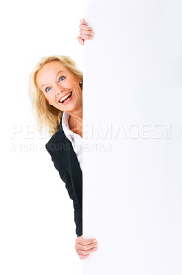 Buy stock photo Studio portrait of a mature businesswoman standing behind copyspace and isolated on white