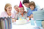 Pretty mature female celebrating with family