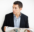 Male entrepreneu looking at copyspace with newspaper