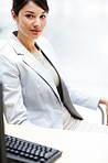 Confident businesswoman looking at you while atoffice