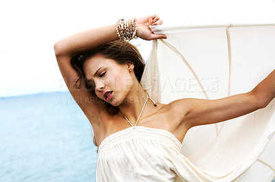 Buy stock photo Beautiful woman in fashion pose with the sea behind her - copyspace
