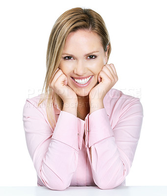 Buy stock photo Portrait of a relaxed female sitting at a table with a smile