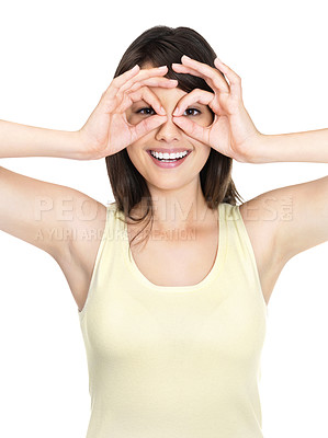 Buy stock photo Happy young woman looking through circled finger against white