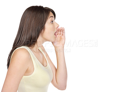Buy stock photo Side view of a young woman whispering to someone against white